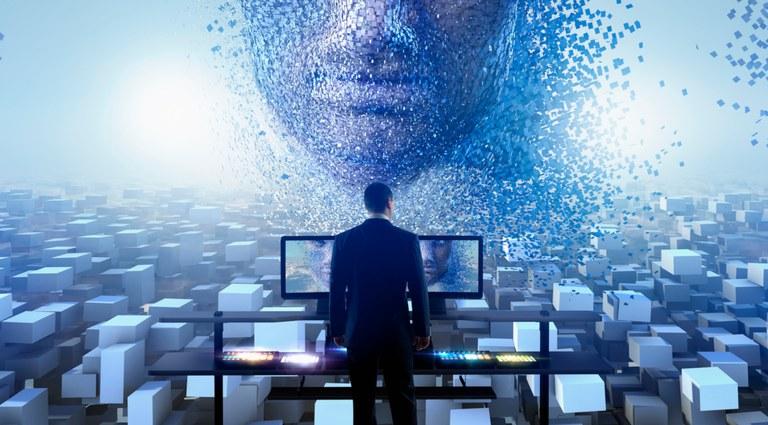 """Ilustração com um homem de costas, olhando vários blocos e duas telas de computador, que """"projetam"""" uma face"""