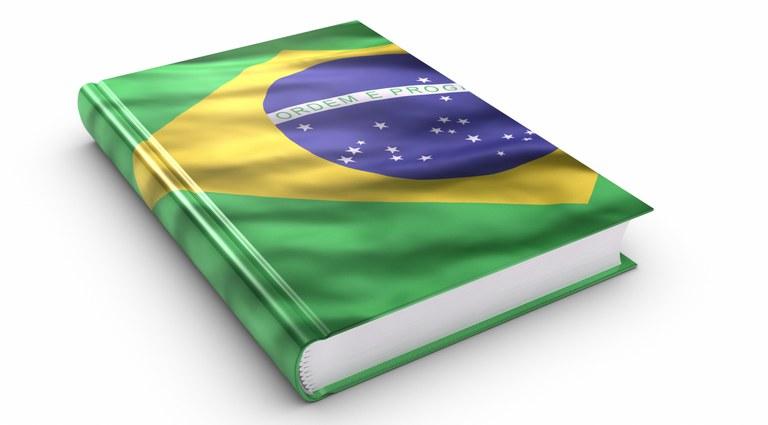 Ilustração de um livro com a bandeira do Brasil sendo a capa